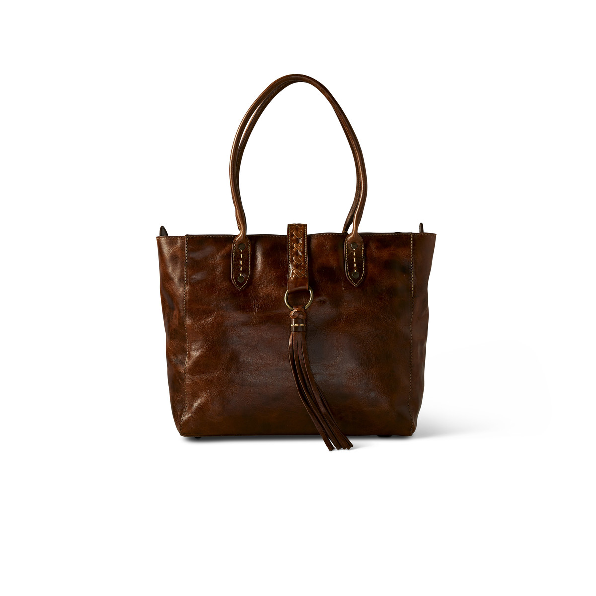 hand-brushed leather tote with its hand-braided leather and tassel fringe represents Western elegance at its best